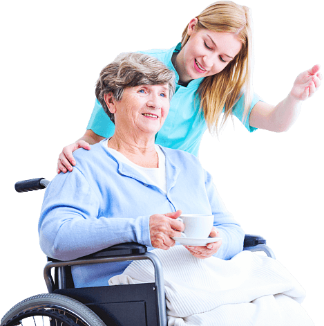 elderly woman on wheelchair and caregiver smiling