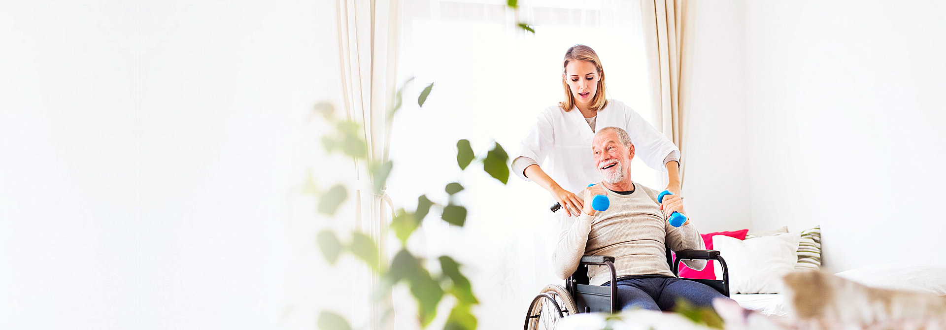 caregiver assisting senior on wheelchair