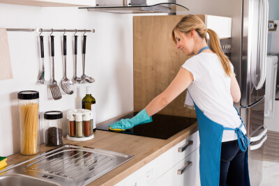 caregiver cleaning in the kitchen
