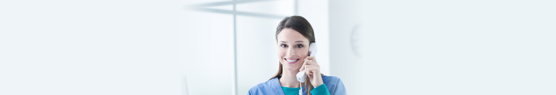 female caregiver on the phone